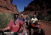 Bandit-style bandannas shield law abiders from dust on a well-worn trail in Fisher Towers region of the Castle Valley near Moab, Utah. Off-road vehicle riders who stick to BLM's loosely enforced straight-and-narrow are plentiful, but thousands more desregard rules, answering the call of their combustion engines for fresh ground?with growing ecological consequences.