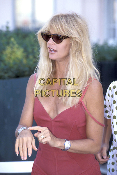 GOLDIE HAWN.Deauville Film Festival.half length half-length big tortoiseshell sunglasses red sun dress silver watch bracelets pointingfinger gesture.ref:026.www.capitalpictures.com.sales@capitalpictures.com.©Capital Pictures