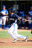Seattle Mariners minor league infielder Timmy Lopes #5 during an instructional league game against the Kansas City Royals at the Peoria Sports Complex on October 2, 2012 in Peoria, Arizona.  (Mike Janes/Four Seam Images)