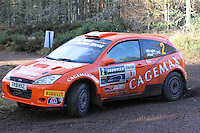 David Bogie - Kevin Rae in a Ford Focus WRC competing at Junction 6 on the Munro Scotch Beef Millbuie Special Stage 1 on the 2014 Arnold Clark/Thistle Hotel Snowman Rally, supported by Highland Office Equipment, part of Capital Document Solutions which was organised by Highland Car Club and based in Inverness on 22.2.14; Round 1 of the 2014 RAC MSA Scottish Rally Championship sponsored by ARR Craib Transport Limited.