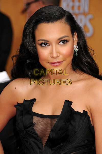 Naya Rivera (wearing Donna Karan).Arrivals at the 19th Annual Screen Actors Guild Awards at the Shrine Auditorium in Los Angeles, California, USA..27th January 2013.SAG SAGs headshot portrait black strapless satin silk corseted corset sheer accordion pleating decolletage cleavage .CAP/ADM/BP.©Byron Purvis/AdMedia/Capital Pictures