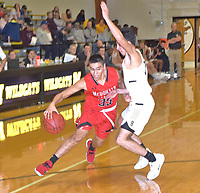 RICK PECK/SPECIAL TO MCDONALD COUNTY PRESS<br /> McDonald County's Saul Garcia drives to the basket while being guarded by Bentonville's Josh Smith during the Mustangs' 73-36 loss on Dec. 27 in the opening round of the 64th Neosho Holiday Classic.