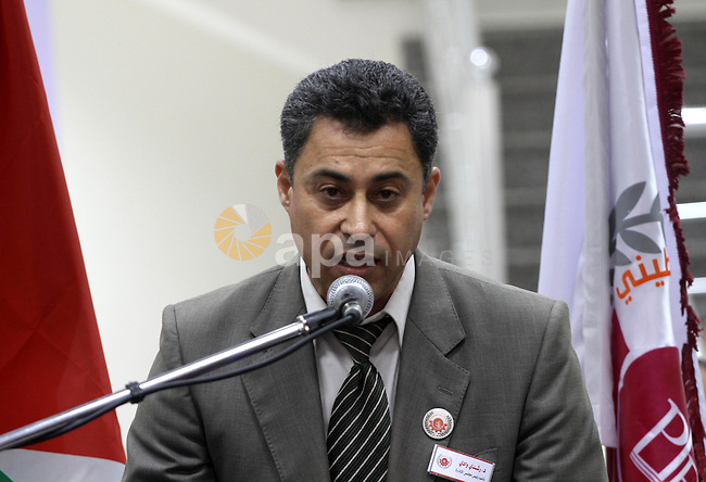 """Rochdi Wadi, vice Chairman of the board of the Palestinian Production Bank speaks during the opening ceremony  in Gaza City on May 27, 2013. The Palestine Monetary Authority warned of dealing with """"Production Bank"""", which has been recently announced in Gaza Strip, said it is not applied for a license to initiate banking business in accordance with the provisions of the Palestine Monetary Authority Law 2/1997 and Banks Law 9/2010. Photo by Mohammed Asad"""