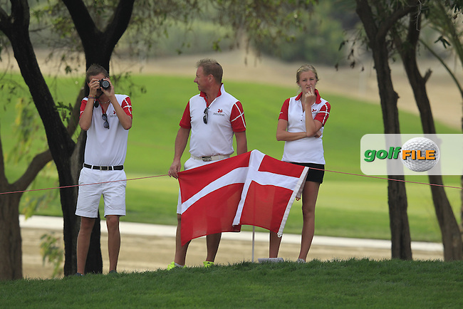 Danish fans follow Morten Orum Madsen (DEN) during Sunday's Final Round of the Abu Dhabi HSBC Golf Championship 2015 held at the Abu Dhabi Golf Course, United Arab Emirates. 18th January 2015.<br /> Picture: Eoin Clarke www.golffile.ie