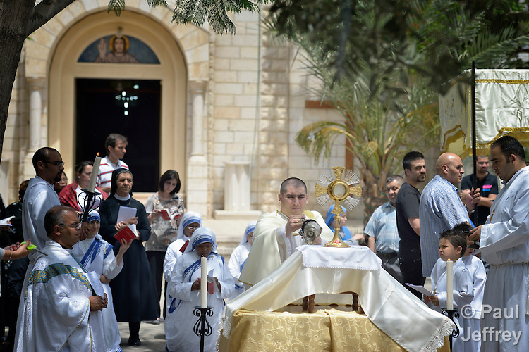 Father Jorge Hernandez leads a Corpus Christi procession outside the Holy Family Catholic Parish in Gaza City. Father Hernandez is Argentinian, and a missionary of the Argentina-based Institute of the Incarnate Word.