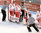 Chris Federico speaks to Max Nicastro (BU - 7) and Garrett Noonan (BU - 13) while Derek Army (PC - 19) is still trapped inside the net. - The Boston University Terriers defeated the visiting Providence College Friars 6-1 on Friday, January 20, 2012, at Agganis Arena in Boston, Massachusetts.