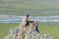 Jonathan Bennett stand on a crag overlooking the Kongakut River, in Alaska's Arctic National Wildlife Refuge.