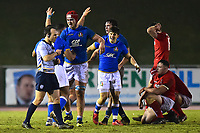 The Wales U20's players look dejected as Italy U20's celebrate<br /> <br /> Photographer Richard Martin-Roberts/CameraSport<br /> <br /> Six Nations U20 Championship Round 4 - Wales U20s v Italy U20s - Friday 9th March 2018 - Parc Eirias, Colwyn Bay, North Wales<br /> <br /> World Copyright &copy; 2018 CameraSport. All rights reserved. 43 Linden Ave. Countesthorpe. Leicester. England. LE8 5PG - Tel: +44 (0) 116 277 4147 - admin@camerasport.com - www.camerasport.com