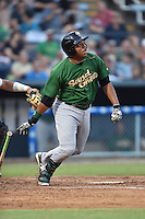 Savannah Sand Gnats first baseman Dominic Smith #22 swings at a pitch during a game against the Asheville Tourists at McCormick Field September 3, 2014 in Asheville, North Carolina. The Tourists defeated the Sand Gnats 8-3. (Tony Farlow/Four Seam Images)