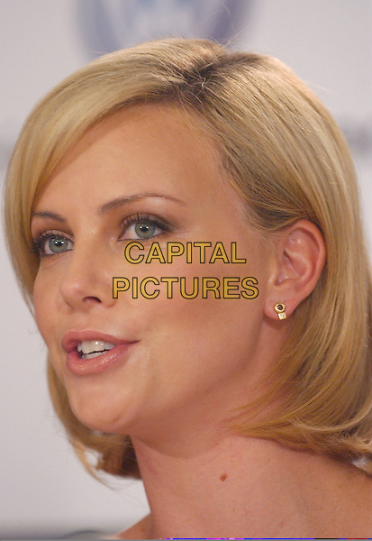 "CHARLIZE THERON.""North Country"" Press conference held at Sutton Place,.Toronto Film Festival,.Toronto, 12th September 2005.portrait headshot.Ref: FARR.www.capitalpictures.com.sales@capitalpictures.com.© Capital Pictures."