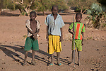 Young boys who care for cattle in Gidel, a village in the Nuba Mountains of Sudan. The area is controlled by the Sudan People's Liberation Movement-North, and frequently attacked by the military of Sudan.