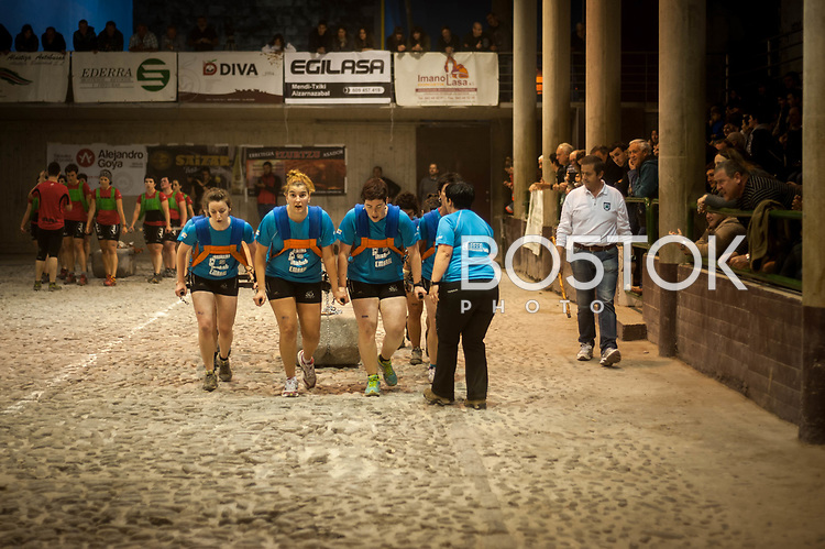Members of 'Emarri' team in full effort in the human stone dragging contest in Aia (Basque Country) on May 17, 2014. This is a sport contest where a 8 persons team drag a 550 kg stone (on women's modality) across a field that measures between 22 and 28 metres. The team that completes more fields within an agreed period of time wins the contest. (Gari Garaialde / Bostok Photo)