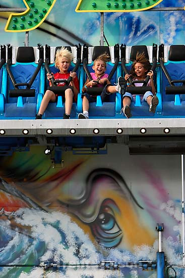 Plunging down on the midway attraction &quot;Moby Dick&quot; are (left to right) Jesse Christiansen, McKenzie Christiansen, and Shannon Silva during the first day of the Utah State Fair in Salt Lake City.; 9.07.2006<br />