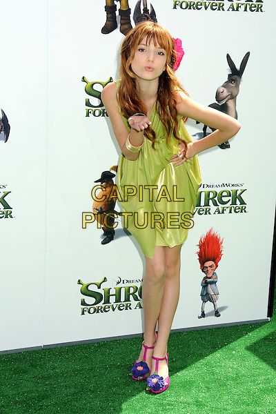 "BELLA THORNE.""Shrek Forever After"" Los Angeles Premiere held at the Gibson Amphitheatre, Universal City, California, USA..May 16th, 2010.full length green dress pink flower in hair shoes purple t-bar hand on hip blowing kiss.CAP/ADM/BP.©Byron Purvis/AdMedia/Capital Pictures."