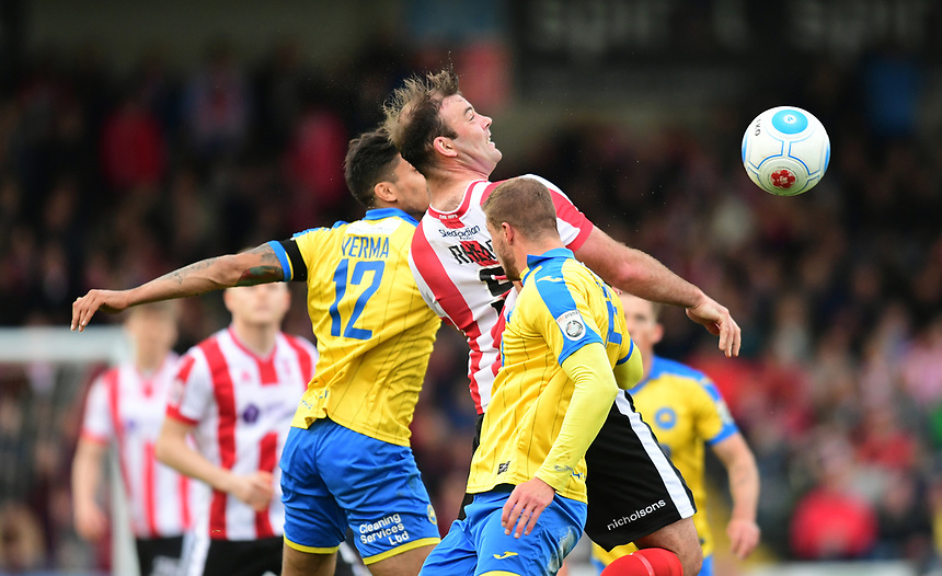 Lincoln City's Matt Rhead vies for possession with Torquay United's Aman Verma, left, and Torquay United's Sean McGinty<br /> <br /> Photographer Chris Vaughan/CameraSport<br /> <br /> Vanarama National League - Lincoln City v Torquay United - Friday 14th April 2016  - Sincil Bank - Lincoln<br /> <br /> World Copyright &copy; 2017 CameraSport. All rights reserved. 43 Linden Ave. Countesthorpe. Leicester. England. LE8 5PG - Tel: +44 (0) 116 277 4147 - admin@camerasport.com - www.camerasport.com