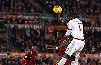 Calcio, Serie A: Roma vs Milan. Roma, stadio Olimpico, 9 gennaio 2016.<br /> AC Milan's Cristian Zapata, right, jumps over Roma's Antonio Ruediger during the Italian Serie A football match between Roma and Milan at Rome's Olympic stadium, 9 January 2016.<br /> UPDATE IMAGES PRESS/Riccardo De Luca