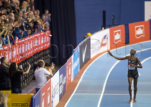 February 18th 2017,  Birmingham, Midlands, England; IAAF The Müller Indoor Grand Prix Athletics meeting; Mo Farah (GBR) waves to the supporters on his victory lap after winning the final of the Men's 5000 Metres in a new National Record time of 13:09.16
