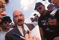 Washington, DC - Convicted Watergate Plumber and Radio Talk Show host G Gordon Liddy, surround by patriot supporters, speaking with a reporter at a pro-gun rally organized by the Committee for 1776,