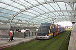 Metro train on grass tracks Oporto airport station, Porto, Portugal Aeroporto Francisco sa Carnero