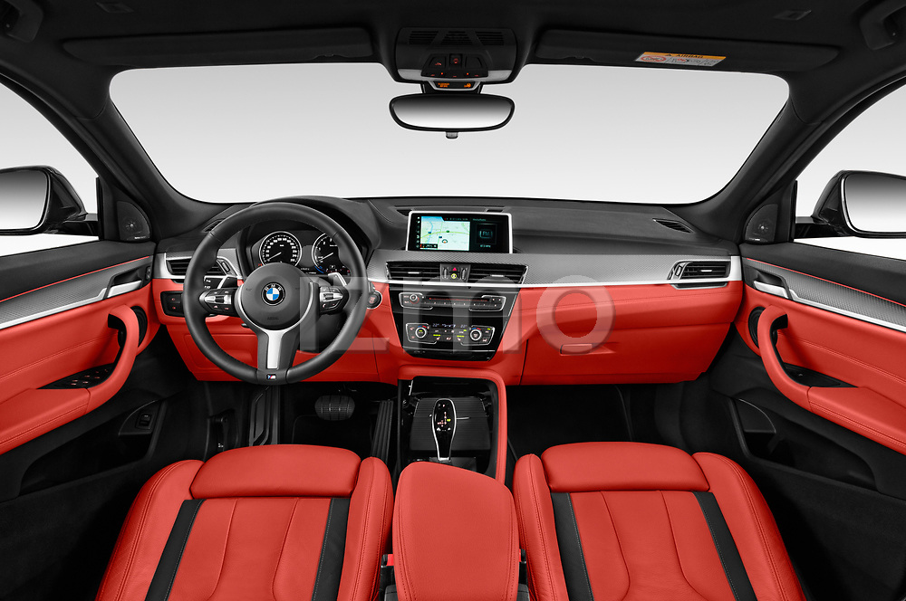 Stock photo of straight dashboard view of 2019 BMW X2 M35 5 Door SUV Dashboard