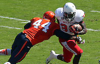 Virginia linebacker Henry Coley (44) tackles -Ball State running back Jahwan Edwards (32)  Ball State defeated Virginia 48-27 during an NCAA football game Saturday Oct. 5, 2013 at Scott Stadium in Charlottesville, VA. Photo/Andrew Shurtleff