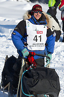 Martin Buser on Long Lake at the Re-Start of the 2012 Iditarod Sled Dog Race