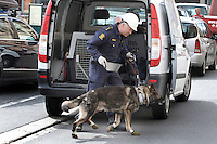 (Oslo July 26, 2011) Police man and dog about to search bombed government buildings. ..A large vehicle bomb was detonated near the offices of Norwegian Prime Minister Jens Stoltenberg on 22 July 2011. .Another terrorist attack took place shortly afterwards, where a man killed 68 people, mainly children and youths attending a political camp at Utøya island. ..Anders Behring Breivik was arrested on the island and has admitted to carrying out both attacks..(photo:Fredrik Naumann/Felix Features)