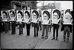 Marchers hold aloft posters of the Ayatollah Khomeini after the Shah's departure. Tehran. January 16, 1979.