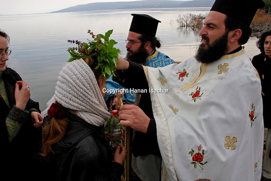 Israel, Capernaum by the Sea of Galilee. The Greek Orthodox Blessing the Water Ceremony on Theophany holiday at the Church of the Twelve Apostles, 2005<br />
