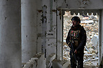 A policeman patrols the ruins of the Al Tahira Catholic Church in the Old City of Mosul, Iraq, on November 30, 2018. Built sometime in the 7th or 8th Centuries, the church was blown up by ISIS combatants during the final moments of the 2017 Battle of Mosul.