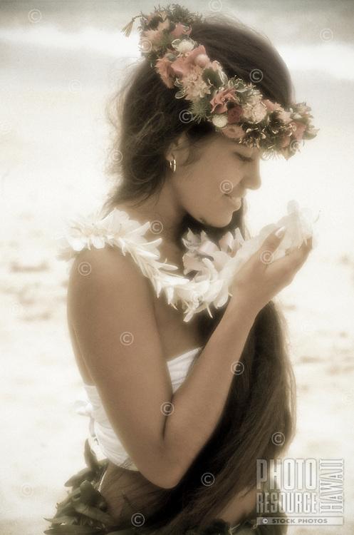 Young Hawaiian woman with ginger and haku leis