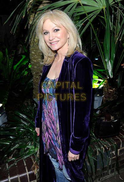 "DEBBIE ARNOLD .at the film premiere of ""Dirty Oil"", Barbican Centre, London, England, UK, 15th March 2010..half length purple velvet blazer jacket print blue top pink side smiling .CAP/FIN.©Steve Finn/Capital Pictures"