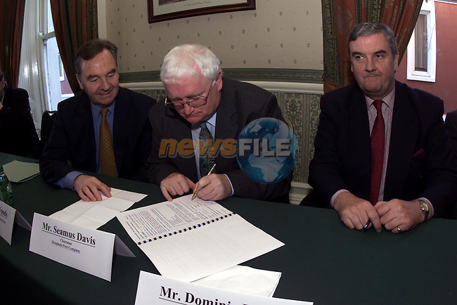 Seamus Davis Chairman Drogheda Port Company signing the dredging contract with Minister of the Marine Michael Woods T.D. and Dominic Healy of the Irish Dredging Company...Camera:   DCS620C.Serial #: K620C-01974.Width:    1728.Height:   1152.Date:  29/11/99.Time:   12:48:32.DCS6XX Image.FW Ver:   1.9.6.TIFF Image.Look:   Product.Tagged.Counter:    [260].Shutter:  1/60.Aperture:  f5.6.ISO Speed:  200.Max Aperture:  f2.8.Min Aperture:  f22.Focal Length:  16.Exposure Mode:  Manual (M).Meter Mode:  Color Matrix.Drive Mode:  Continuous High (CH).Focus Mode:  Continuous (AF-C).Focus Point:  Center.Flash Mode:  Normal Sync.Compensation:  +0.0.Flash Compensation:  +0.0.Self Timer Time:  10s.White balance: Auto (Flash).Time: 12:48:32.430.