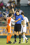 27 May 2015: Referee Matthew Franz (right) shows the yellow card to Carolina's Wells Thompson (9). The Carolina RailHawks hosted the Charlotte Independence at WakeMed Stadium in Cary, North Carolina in a 2015 Lamar J. Hunt United States Open Cup Third Round match. Charlotte won the game 1-0.