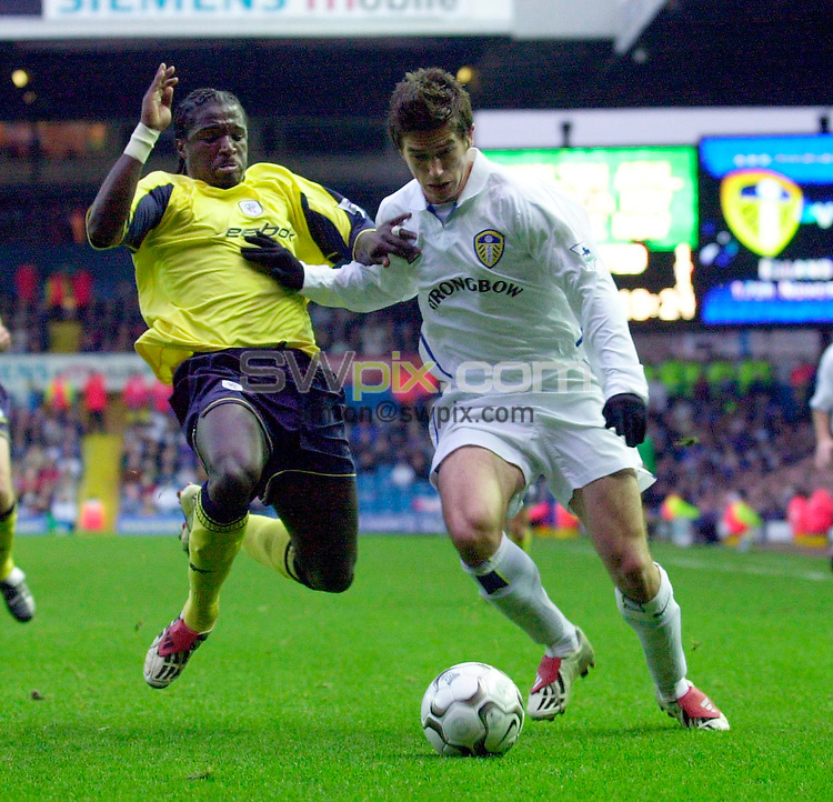 Pix: Ben Duffy/SWpix.com..... Barclaycard Premiership football...Leeds United v Bolton Wanderers...17/11/2002..COPYRIGHT PICTURE>>SIMON WILKINSON>>01943 436649>>..Leed's Harry Kewell is put under pressure as Bolton's  Bernard Mendy jumps in