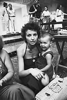 - Emma Bonino, leader del Partito Radicale  durante il XVI Congresso a Roma nel luglio 1976, con la piccola Aurora avuta in affidamento<br /> <br /> - Emma Bonino, leader of the Radical Party during the XVI Congress in Rome in July 1976, with the young Aurora had in custody