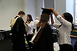 Graduating students being dressed in gown and mortarboard, Goldsmiths, University of London, England, UK