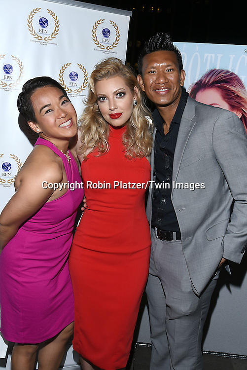 Ester Barosso Guerzon and Albert Guerzon and Dalal Bruchmann attend the &quot;EPN Spotlight Magazine&quot;  launch party on June 10, 2016 at the Renaissance NY Hotel in New York, New York, USA. Dalal Bruchmann is the cover model.<br />