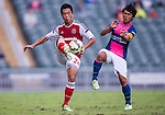 Kong Wai Lo of SCAA (L) competes for the ball with Kwan Yee Lo of Kitchee (R) during the HKFA Premier League between South China Athletic Association vs Kitchee at the Hong Kong Stadium on 23 November 2014 in Hong Kong, China. Photo by Aitor Alcalde / Power Sport Images