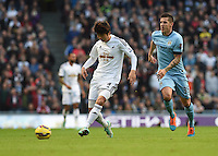 Picture by Howard Roe/AHPIX.com. Football, Barclays Premier League; <br /> Manchester City v Swansea City ;22/11/2014 KO 3.00 pm <br /> Etihad Stadium;<br /> copyright picture;Howard Roe;07973 739229<br /> Swansea's     Ki Sung-Yueng distributes the ball