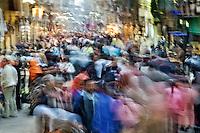 People in motion, crowded street in Khan el Khalili Bazaar, Cairo, Egypt