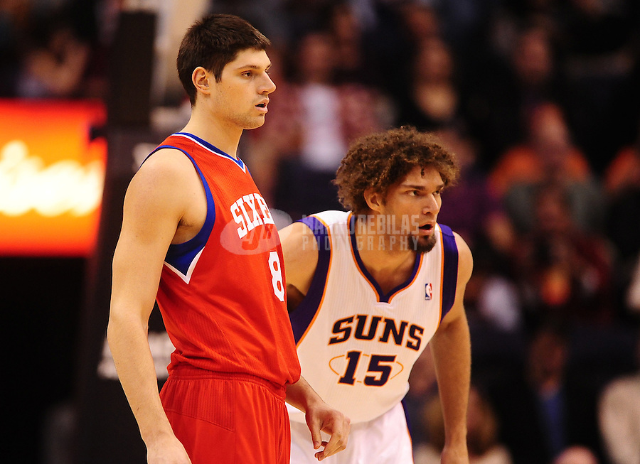 Dec. 28, 2011; Phoenix, AZ, USA; Philadelphia 76ers center/forward Nikola Vucevic (left) and Phoenix Suns center Robin Lopez at the US Airways Center. The 76ers defeated the Suns 103-83. Mandatory Credit: Mark J. Rebilas-USA TODAY Sports