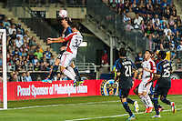 Jeff Parke (31) of the Philadelphia Union heads the ball away from Andrew Wiedeman (32) of Toronto FC. The Philadelphia Union defeated Toronto FC 1-0 during a Major League Soccer (MLS) match at PPL Park in Chester, PA, on October 5, 2013.