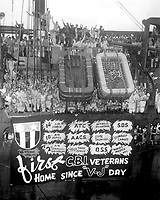 Cheering U.S. veterans of the China-Burma-India campaigns arrive in New York Sept. 27, 1945, aboard the Army transport General A. W. Greely.  The men and women were members of the Flying Tigers, Merrill's Marauders, and other heroic outfits.  INP. (OWI)<br /> NARA FILE #:  208-AA-1H-3<br /> WAR & CONFLICT BOOK #:  1368