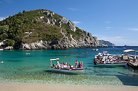 Greece, Corfu, Paleokastritsa: Tour boat docking