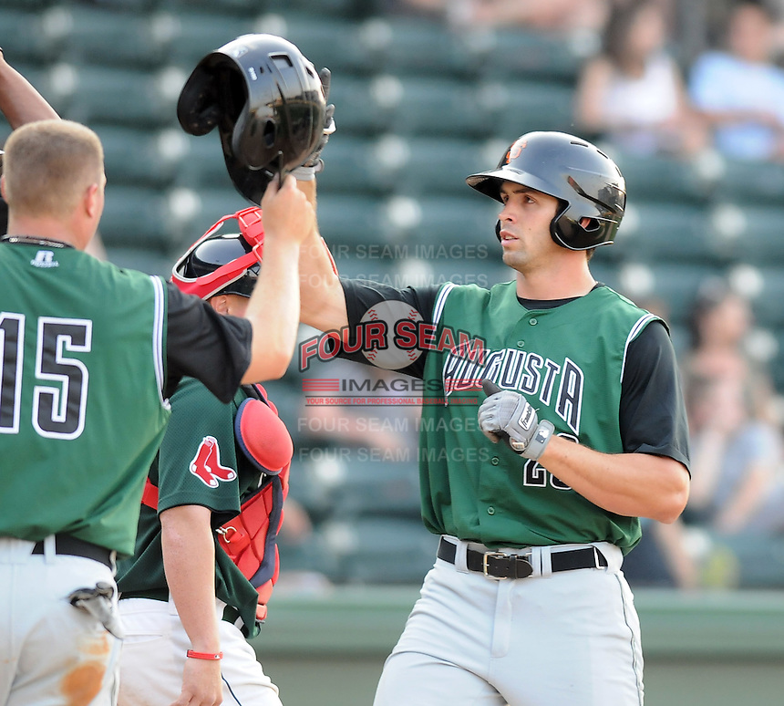 Outfielder Devin Harris (23) of the Augusta GreenJackets is congratulated after hitting a home run in a game against the Greenville Drive on April 10, 2011, at Fluor Field at the West End in Greenville, S.C. Photo by Tom Priddy / Four Seam Images
