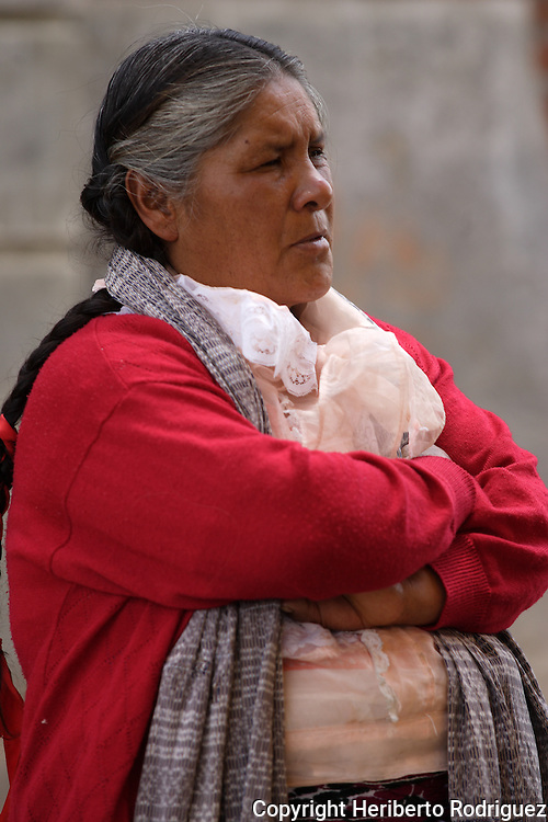 An old Mexican Native Nahnuh gestures during a meeting in the main plaza of Jiquipilco El Viejo, in western Mexico state, April 20, 2005. Photo by Heriberto Rodriguez