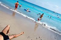Spain. Ibiza in the Balearic islands. Ibiza. Tourists swimm, take a rest and sunbathe on a sandy beach. Mediterranean sea. © 1999 Didier Ruef