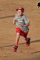 A young fan participates in the Tri-City ValleyCats base race in between innings during a game against the Batavia Muckdogs on August 2, 2014 at Joseph L. Bruno Stadium in Troy, New  York.  Tri-City defeated Batavia 8-4.  (Mike Janes/Four Seam Images)