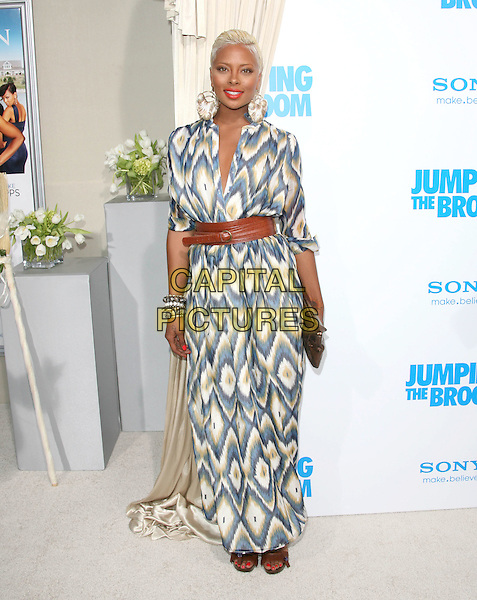 EVA MARCILLE .at The Screen Gems L.A. Premiere of Jumping the Broom held at The Cinerama Dome Theatre in Hollywood, California, USA, May 4th 2011..full length dress long maxi  brown belt pigford red lipstick earrings print white blue  oversized bleached hair  .CAP/RKE/DVS.©DVS/RockinExposures/Capital Pictures.